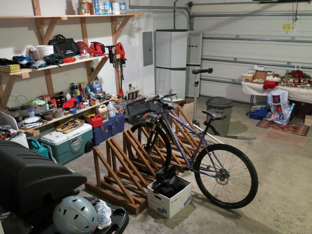 Everything in this photo, including my one remaining mountain bike, would be gone by the end of the sale.