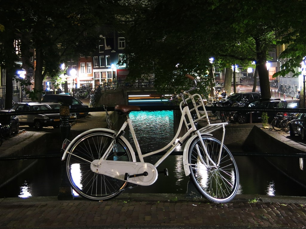 A green-lit canal boat cruised through my shot, adding an ethereal glow to this angelic bike.