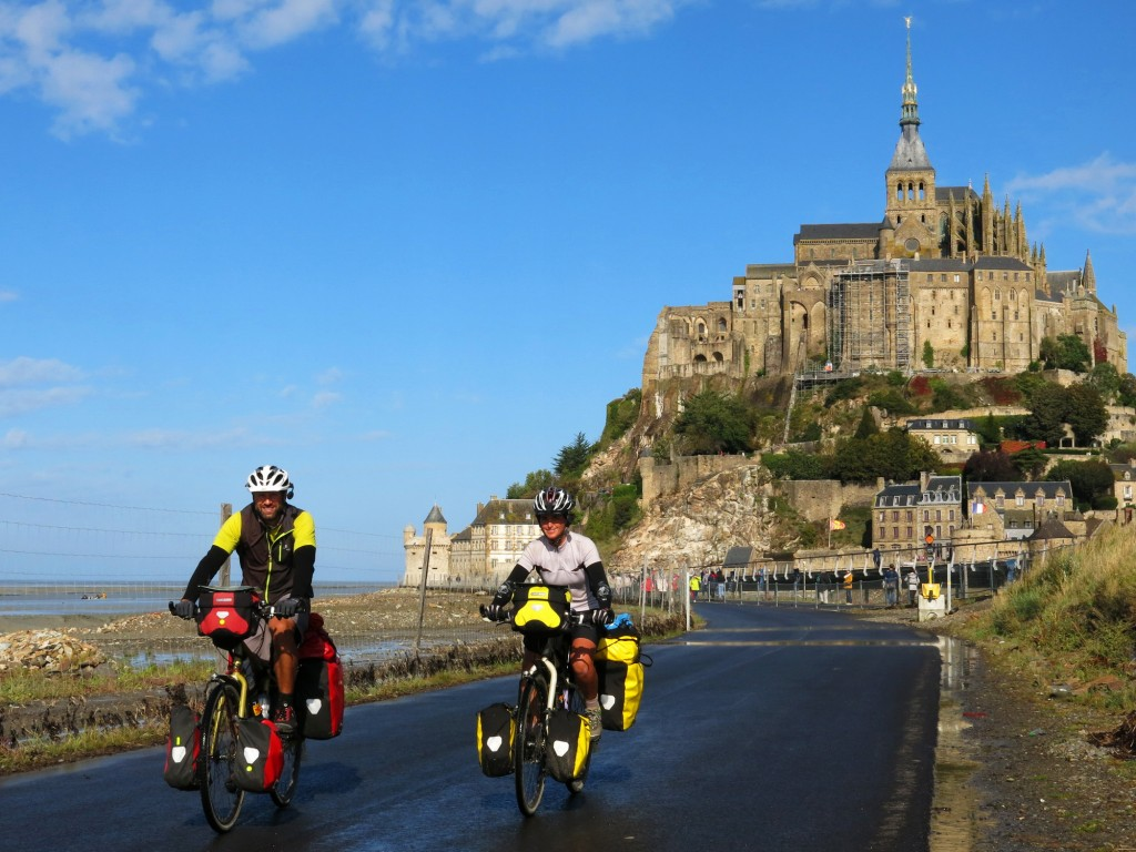 Pedaling away from the magical, fairytale millenium-old Mont Saint Michel abbey.