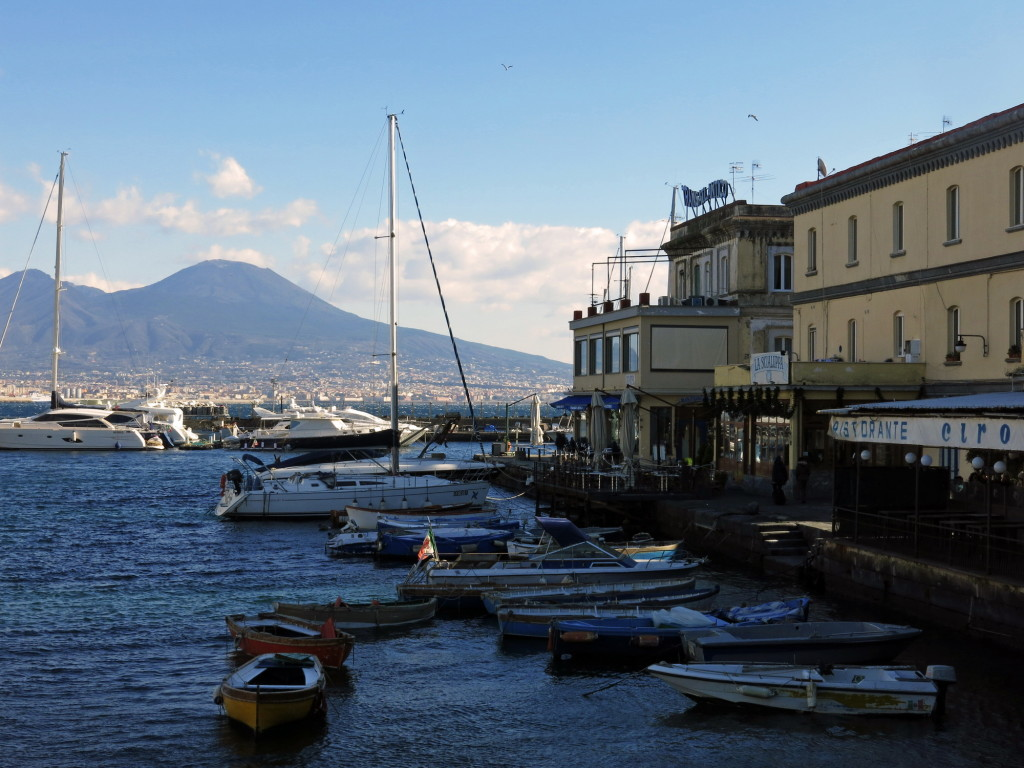 Looking south across the Bay of Naples to Mount Vesuvius from the spit of land connecting Castel dell'Ovo with the Chiai neighborhood in Naples.
