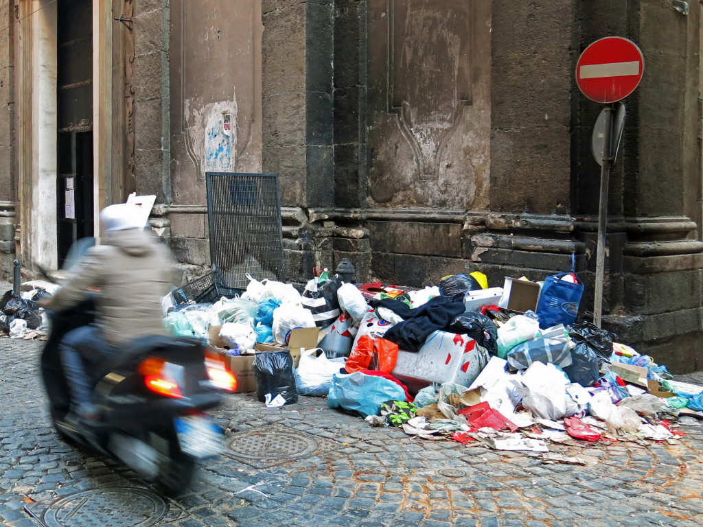 Naples is known for its trash problems. We're told things are much, much better these days than a few years ago. Let that sink in while you look at this photo.