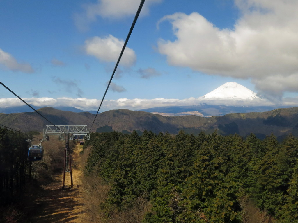 Mt. Fuji comes into view on the Hakone Ropeway after cresting the ridge.