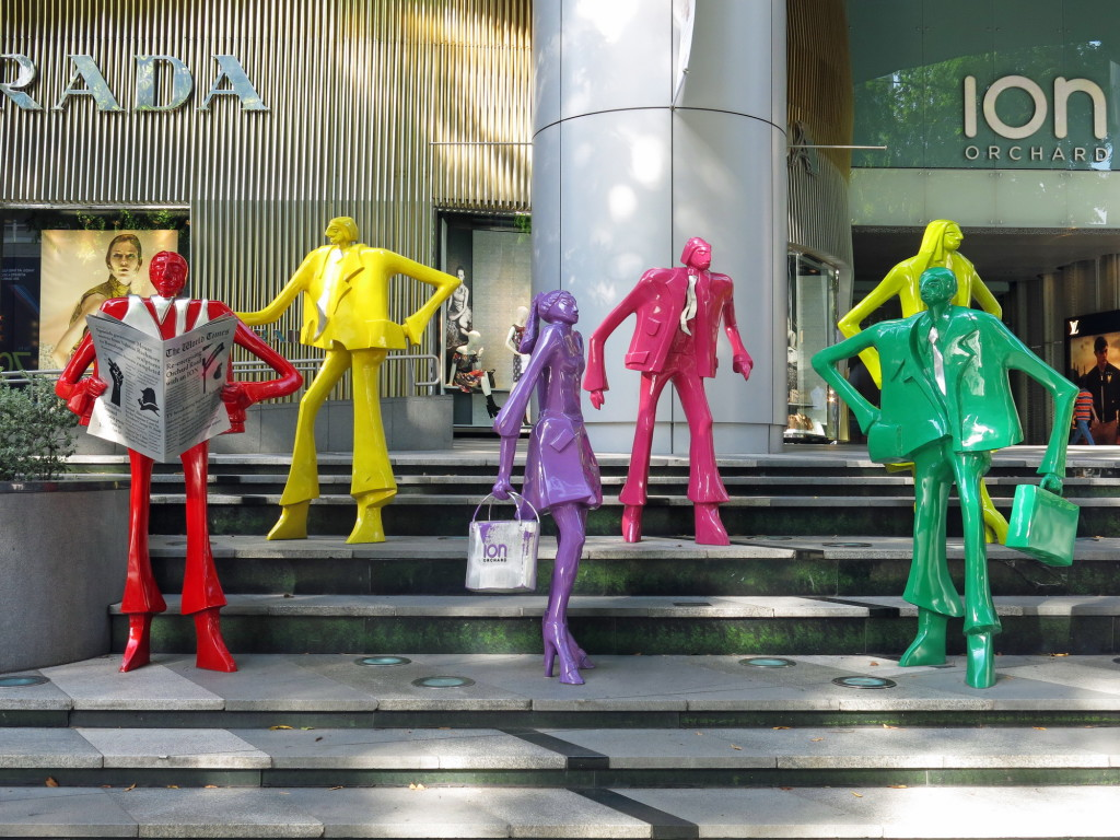 Appropriate art along Orchard Street in Singapore: Businessman posture while ladies shop.