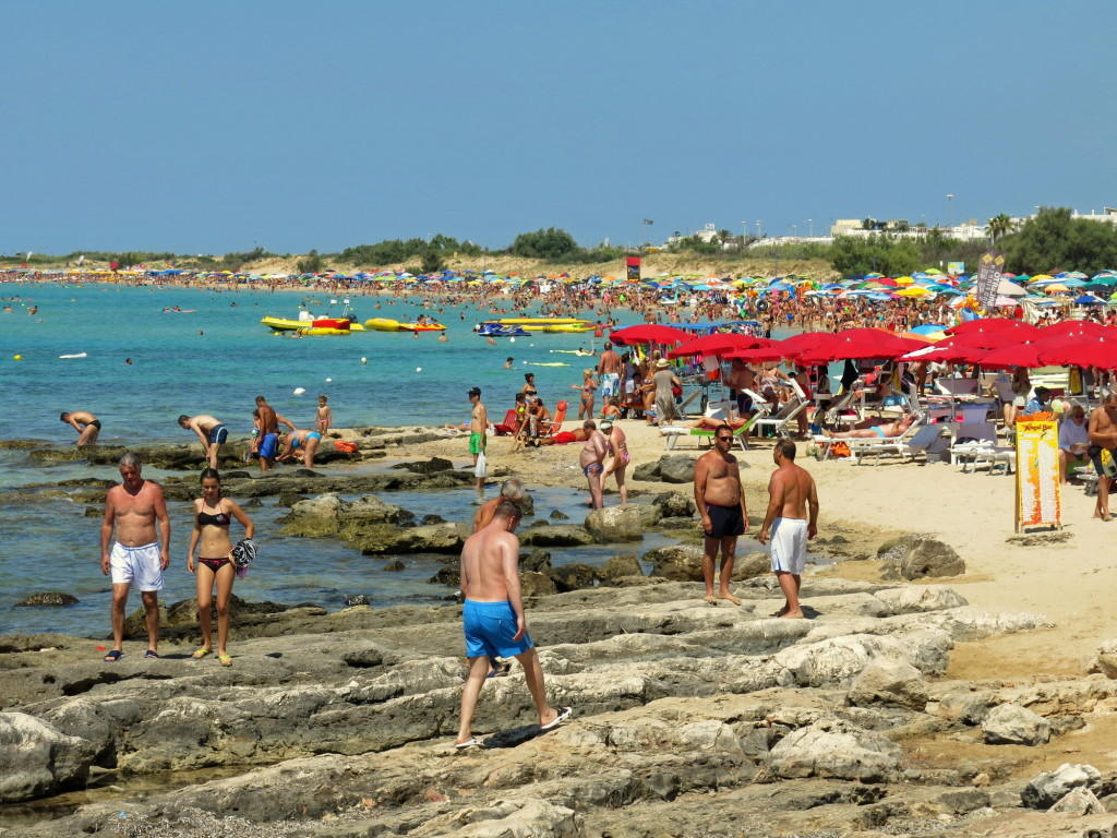 Sand, coral, and crowds. The Ionian side of Salento, particularly north of Ugento, is packed with people.