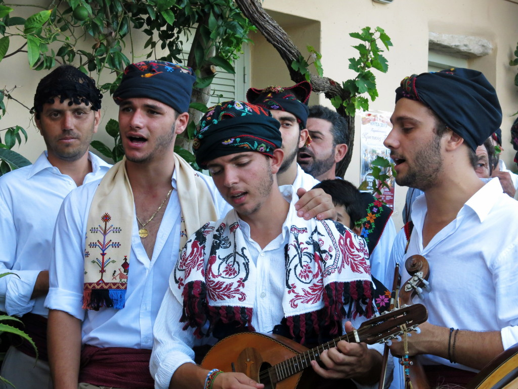 The groom's company sing for him outside his house in Kritsa.