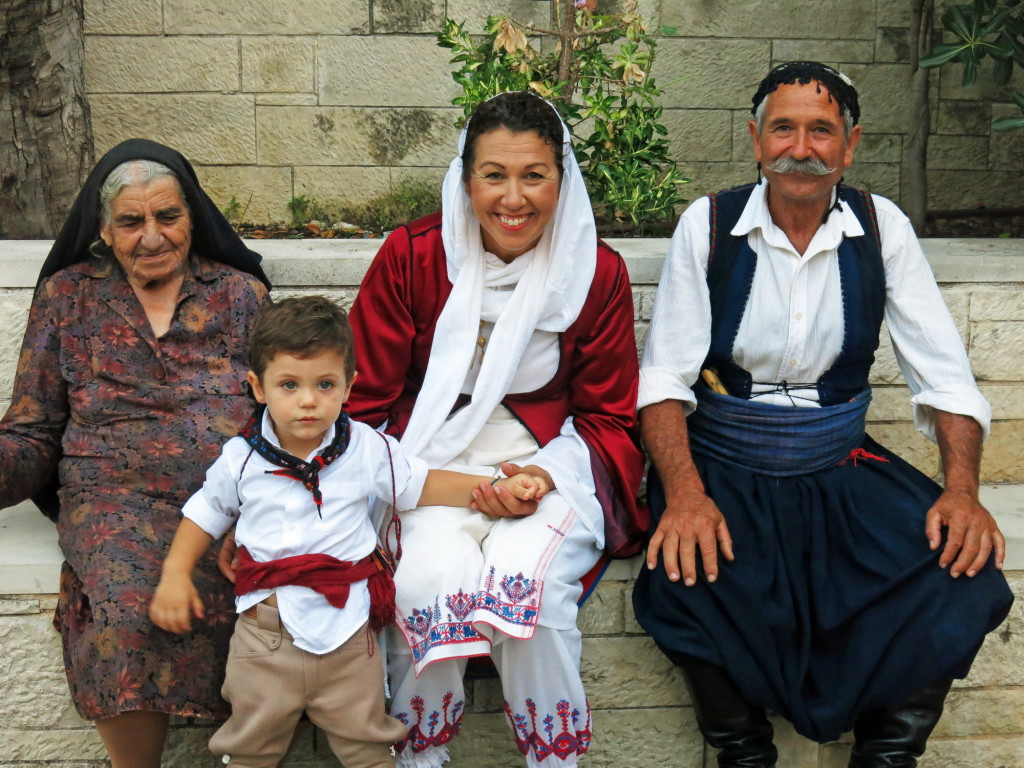 Local family in traditional dress for the wedding in Kritsa.