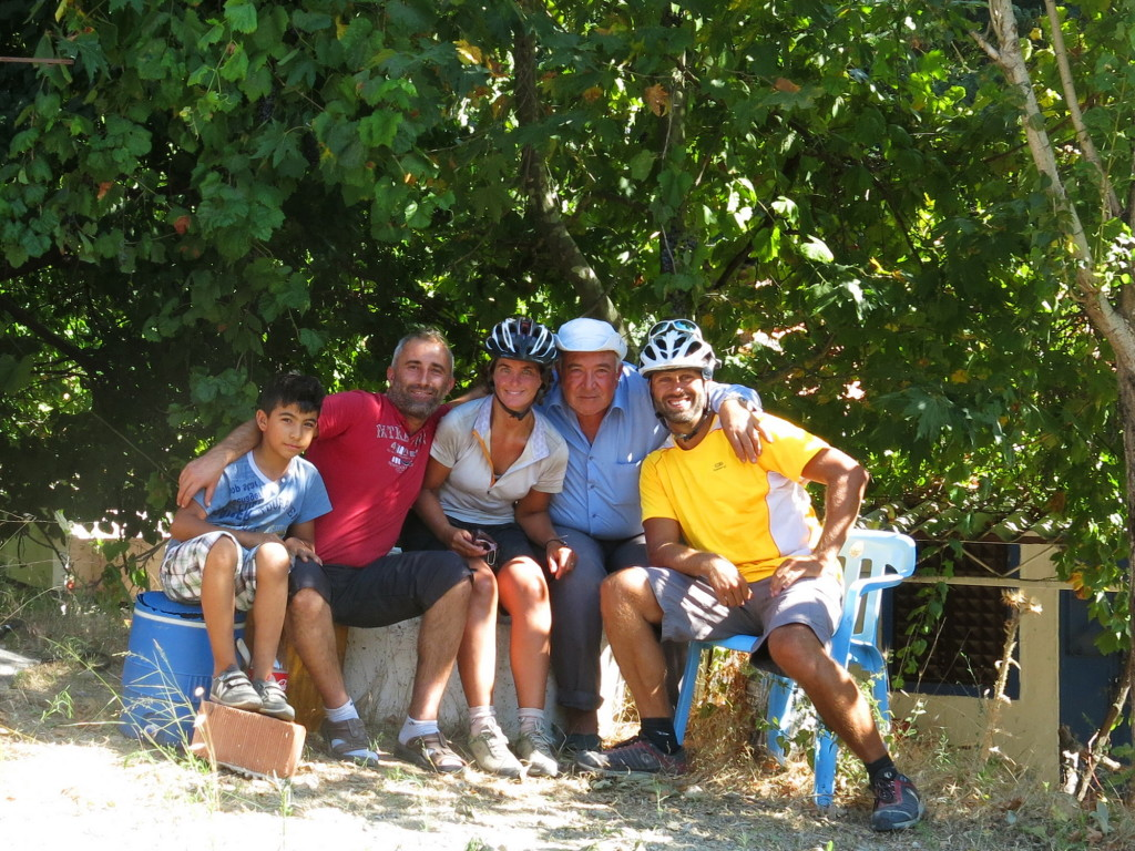 Three generations of honey sellers on the side of the road invited us into the shade for some wine and a chat.