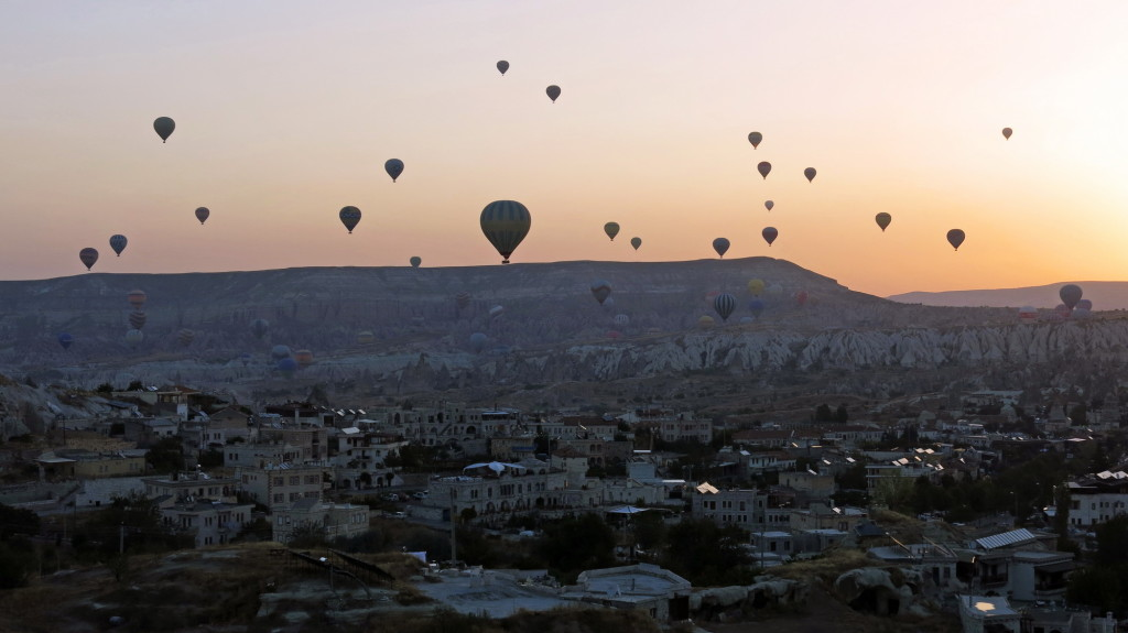Sunrise over the town of Goreme where nearly a hundred balloons set flight almost every morning.