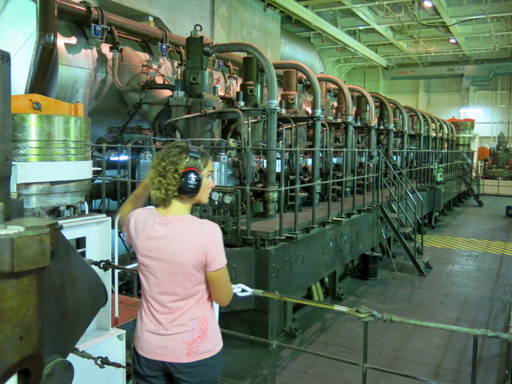 Kristin in front of the 12-cylinder, 90,000 bhp, turbo diesel engine that powers the ship.