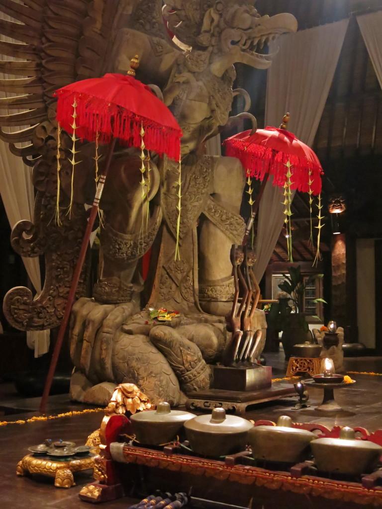 The Garuda wood carving and gamelan instruments at Tugu Hotel Bali's Thursday night Balinese dance in Canggu, Bali.