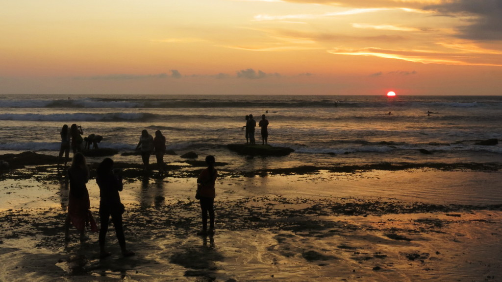 The crowds turn out at Batu Bolong for sunset, just as they do everywhere on Bali's southwest coast.