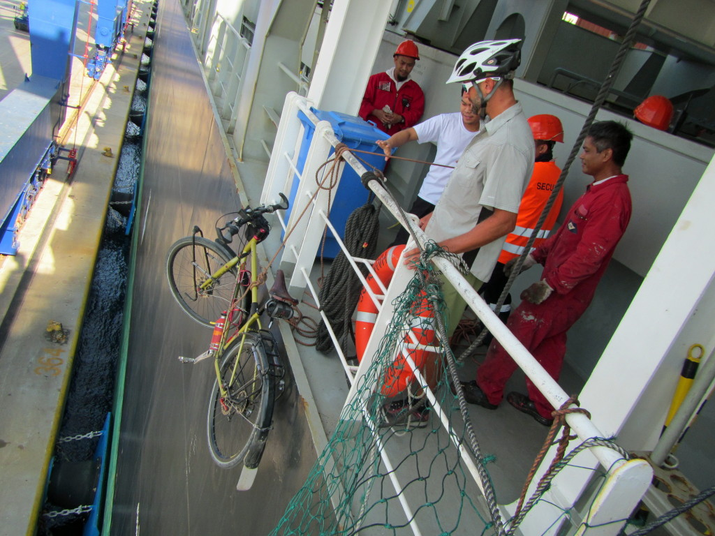 Tense moments as our bikes were hoisted some 20 meters up the side of the ship from the pier.
